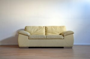 How can I clean my upholstered couch at home